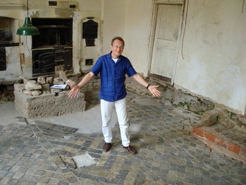 Me in our kitchen soon after we moved into Clifton House showing off the thirteenth century floor tiles